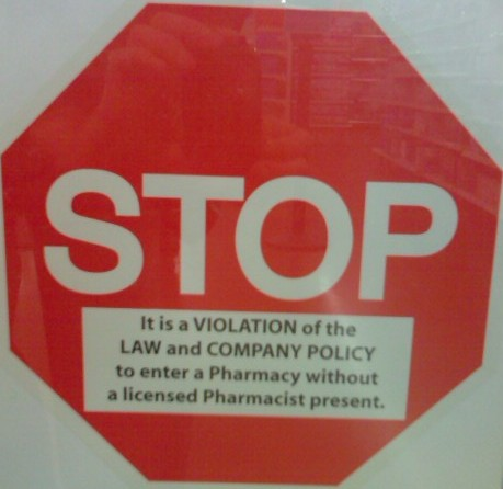 STOP! It is a VIOLATION of the LAW and COMPANY POLICY to enter a Pharmacy without a licensed Pharmacist present.